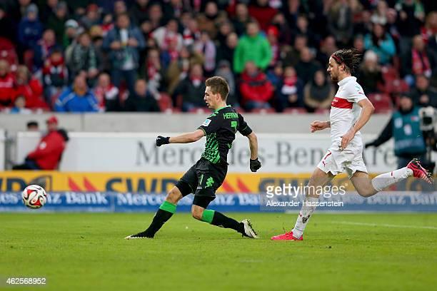 Patrick Herrmann of Gladbach scores the opening goal against Martin Harnik of Stuttgart during the Bundesliga match between VfB Stuttgart and...