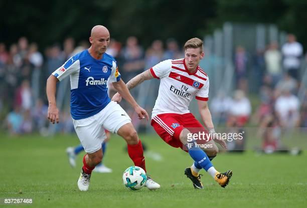 Patrick Herrmann of Holstein Kiel and Andre Hahn of Hamburg battle for the ball during the preseason friendly match between Holstein Kiel and...