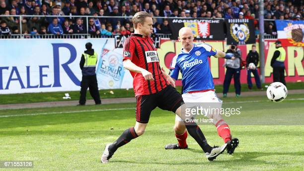 Patrick Herrmann of Kiel and Dennis Grote of Chemnitz compete for the ball during the third league match between Holstein Kiel and Chemnitzer FC at...