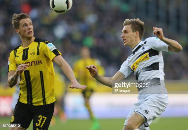 Patrick Herrmann of Moenchengladbach and Erik Durm of Dortmund battle for the ball during the Bundesliga match between Borussia Moenchengladbach and...