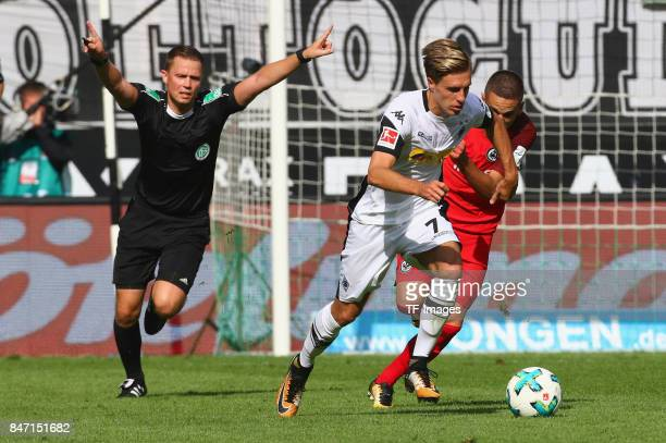 Patrick Herrmann of Moenchengladbach and Mijat Gacinovic of Frankfurt battle for the ball during the Bundesliga match between Borussia...