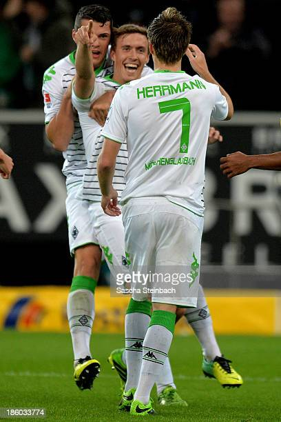 Patrick Herrmann of Moenchengladbach celebrates after scoring his team's third goal with team mate Granit Xhaka and Max Kruse during the Bundesliga...
