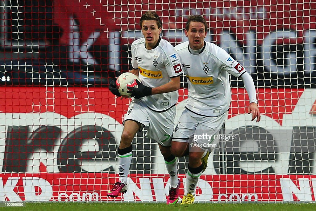 Patrick Herrmann (L) of Moenchengladbach celebrates his team's first goal with team mate Luuk de Jong during the Bundesliga match between 1. FC Nuernberg and VfL Borussia Moenchengladbach at Easy Credit Stadium on February 3, 2013 in Nuremberg, Germany.