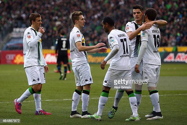 Patrick Herrmann of Moenchengladbach celebrates his team's second goal with team mates during the Bundesliga match between Borussia Moenchengladbach...