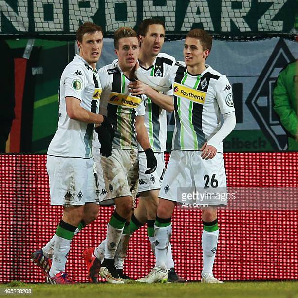Patrick Herrmann of Moenchengladbach celebrates his team's second goal with team mates Max Kruse Roel Brouwers and Thorgan Hazard during the DFB Cup...