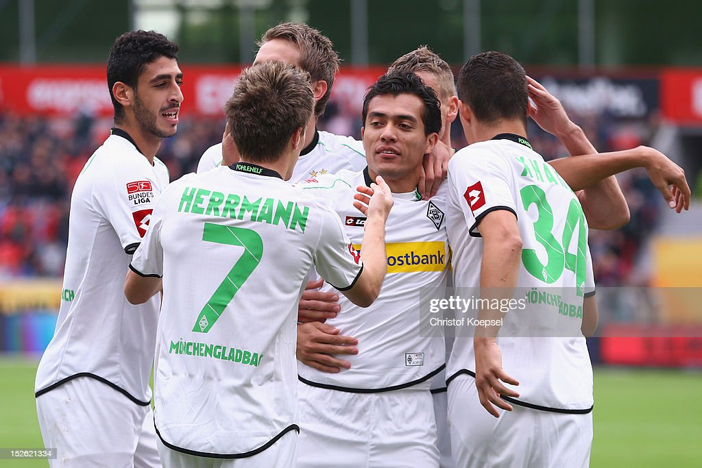 Patrick Herrmann (2nd L) of Moenchengladbach celebrates the first goal with Juan Arango during the Bundesliga match between Bayer 04 Leverkusen and Borussia Moenchengladbach at BayArena on September 23, 2012 in Leverkusen, Germany.