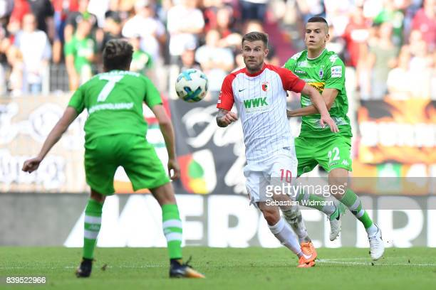 Patrick Herrmann of Moenchengladbach Daniel Baier of Augsburg and Laszlo Benes of Moenchengladbach during the Bundesliga match between FC Augsburg...