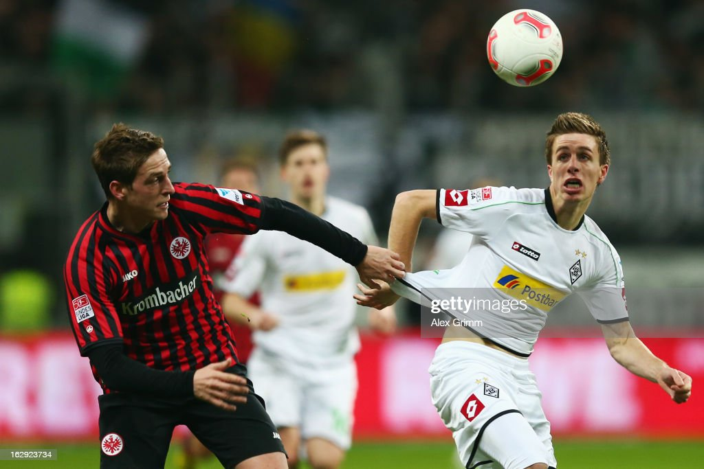 Patrick Herrmann (R) of Moenchengladbach is challenged by <a gi-track='captionPersonalityLinkClicked' href=/galleries/search?phrase=Bastian+Oczipka&family=editorial&specificpeople=4331671 ng-click='$event.stopPropagation()'>Bastian Oczipka</a> of Frankfurt during the Bundesliga match between Eintracht Frankfurt and Borussia Moenchengladbach at Commerzbank-Arena on March 1, 2013 in Frankfurt am Main, Germany.