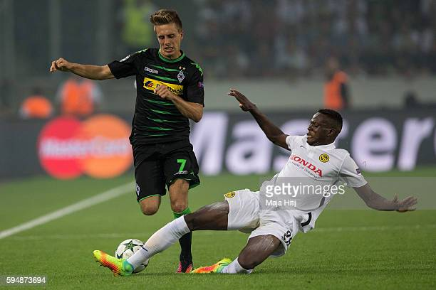 Patrick Herrmann of Moenchengladbach is challenged by Denis Zakaria during the UEFA Champions League Qualifying PlayOffs Round Second Leg between...