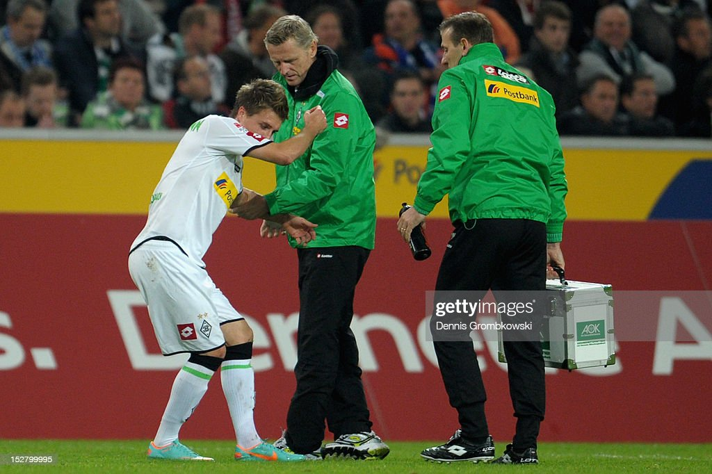 Patrick Herrmann of Moenchengladbach is treated after suffering an injury during the Bundesliga match between Borussia Moenchengladbach and Hamburger SV at Borussia Park Stadium on September 26, 2012 in Moenchengladbach, Germany.