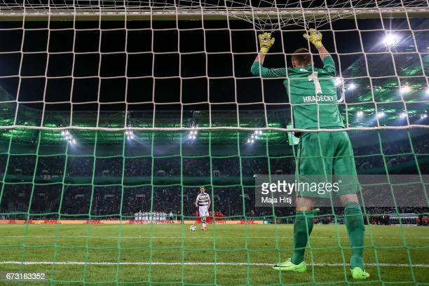 Patrick Herrmann of Moenchengladbach prior penalty shoot out against Lukas Hradecky goal keeper of Frankfurt during the DFB Cup semi final match...