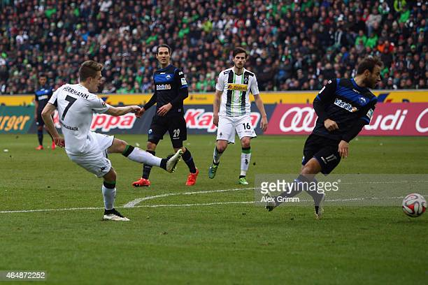 Patrick Herrmann of Moenchengladbach scores his team's second goal against Alban Meha of Paderborn during the Bundesliga match between Borussia...