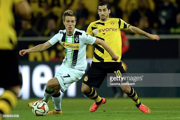 Patrick Herrmann of Moenchengladbach vies with Henrikh Mkhitaryan of Dortmund during the Bundesliga match between Borussia Dortmund and Borussia...