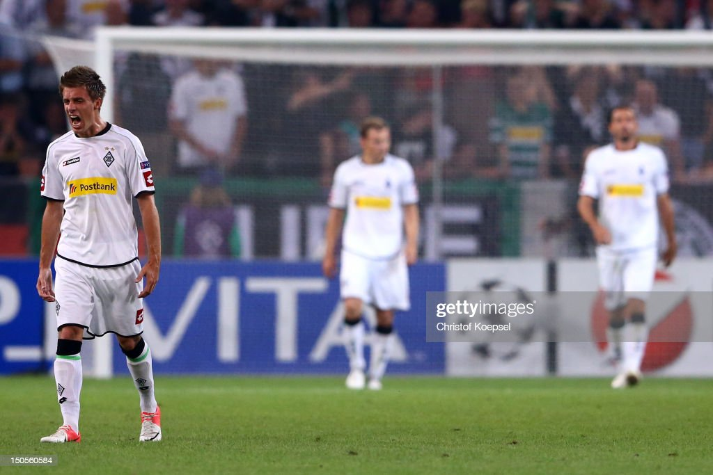 Patrick Herrmann Tony Jantschke and Martin Stranzl of Moenchengladbach look dejected after the third goal of Kiew during the UEFA Champions League...