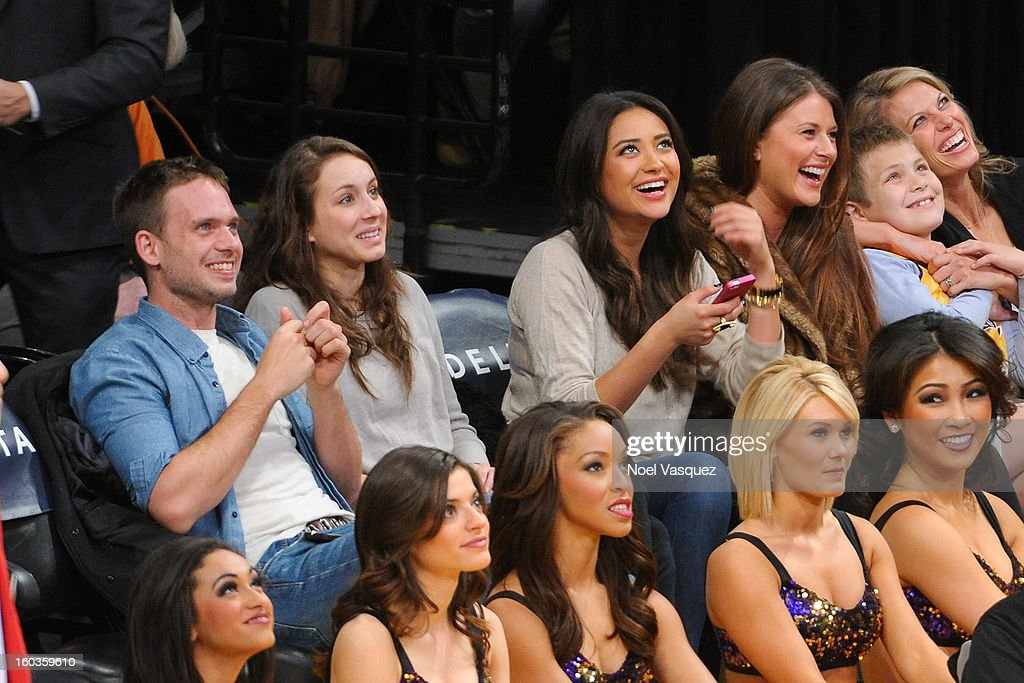Patrick J. Adams, Troian Bellisario, Shay Mitchell and Michaela Blaney attend a basketball game between the New Orleans Hornets and the Los Angeles Lakers at Staples Center on January 29, 2013 in Los Angeles, California.