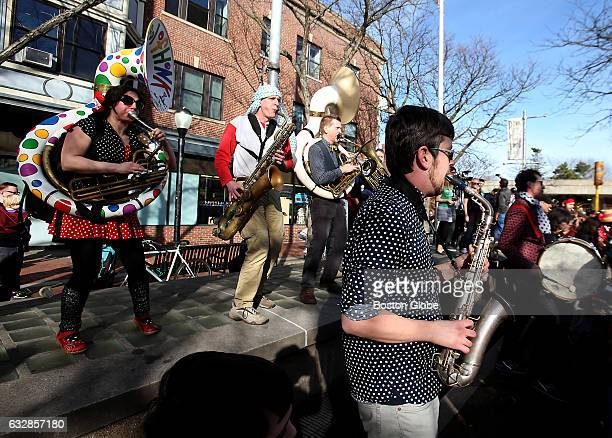 Patrick Johnson plays the sax in Davis Square in Somerville MA with a large brass band celebrating Johnny D's last day in business on Mar 13 2016