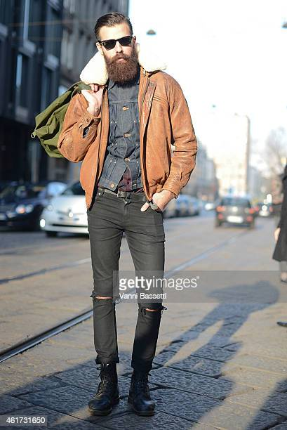 Patrick Jonasson poses wearing a vintage coat Cheap Monday pants and Dr Martens boots during day 2 of Milan Menswear Fashion Week Fall/Winter...