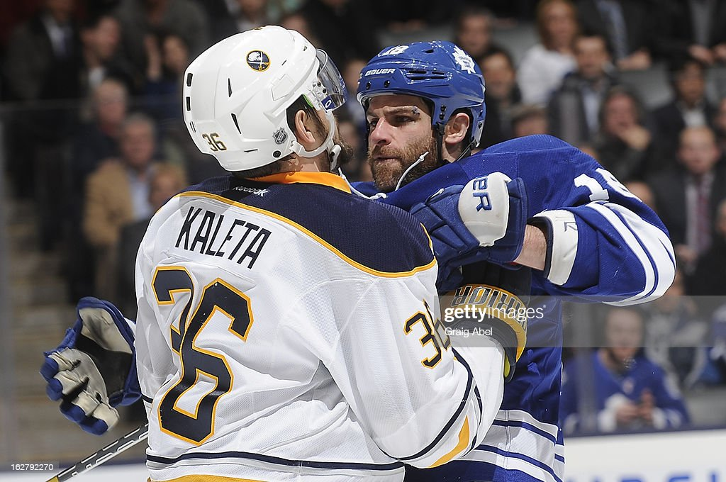 Patrick Kaleta of the Buffalo Sabres battles with Mike Brown of the Toronto Maple Leafs during NHL game action February 21 2013 at the Air Canada...