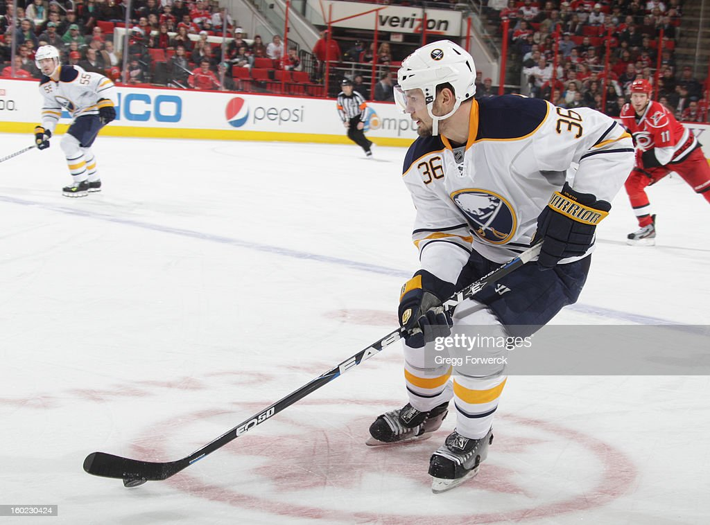 Patrick Kaleta of the Buffalo Sabres carries the puck during their NHL game against the Carolina Hurricanes at PNC Arena on January 24 2013 in...