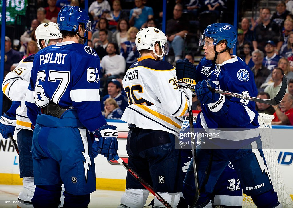 Patrick Kaleta of the Buffalo Sabres confronts Keith Aulie of the Tampa Bay Lightning during the second period of the game at the Tampa Bay Times...