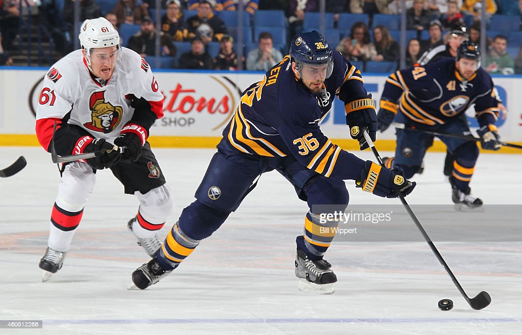 Patrick Kaleta of the Buffalo Sabres controls the puck against Mark Stone of the Ottawa Senators on December 15 2014 at the First Niagara Center in...