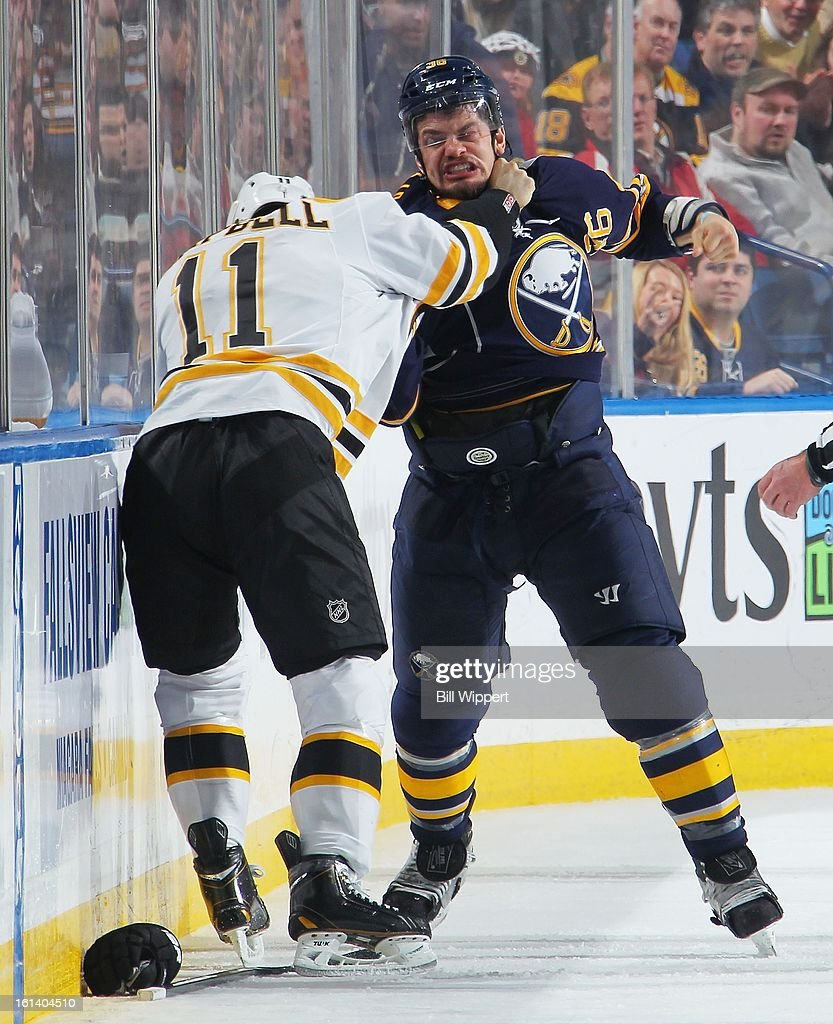 Patrick Kaleta of the Buffalo Sabres fights with Gregory Campbell of the Boston Bruins on February 10 2013 at the First Niagara Center in Buffalo New...
