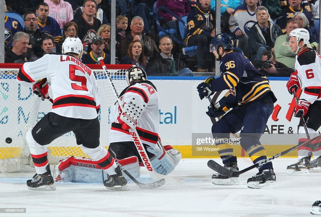 Patrick Kaleta #36 of the Buffalo Sabres scores a first period goal past Martin Brodeur #30 and Adam Larsson #5 of the New Jersey Devils on April 7, 2013 at the First Niagara Center in Buffalo, New York.