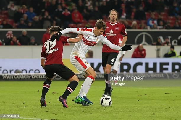 Patrick Kammerbauer of Nuerenberg and Florian Klein of Suttgart battle for the ball during the second Bundesliga match between VfB Stuttgart and 1 FC...