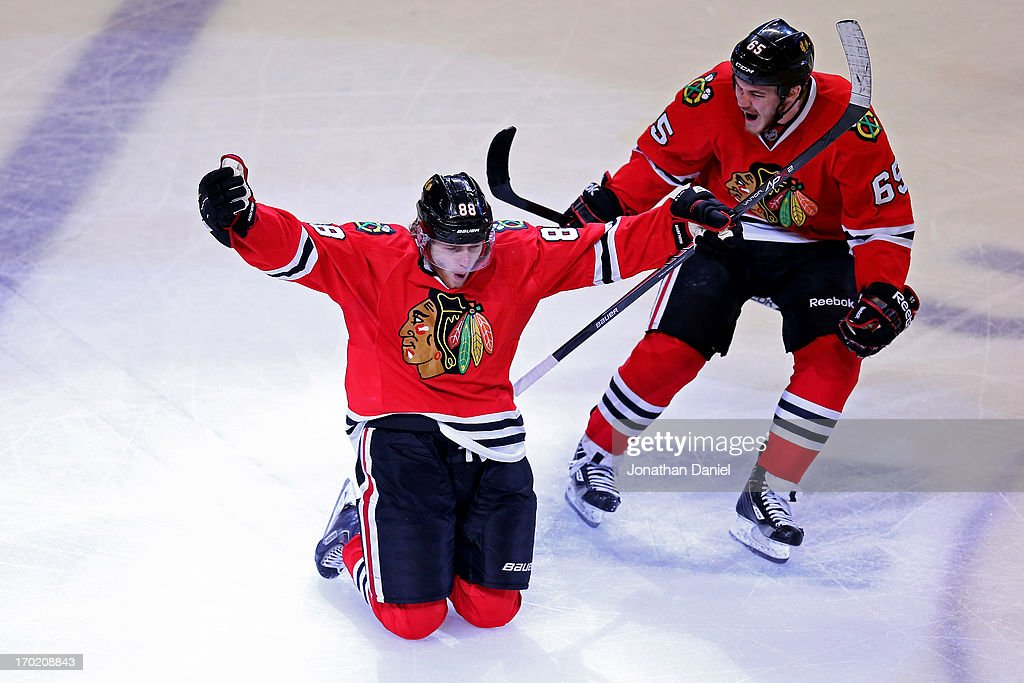Patrick Kane #88 and Andrew Shaw #65 of the Chicago Blackhawks celebrate after Kane scored the game-winning goal in the second overtime period against the Los Angeles Kings during Game Five of the Western Conference Finals of the 2013 NHL Stanley Cup Playoffs at United Center on June 8, 2013 in Chicago, Illinois.