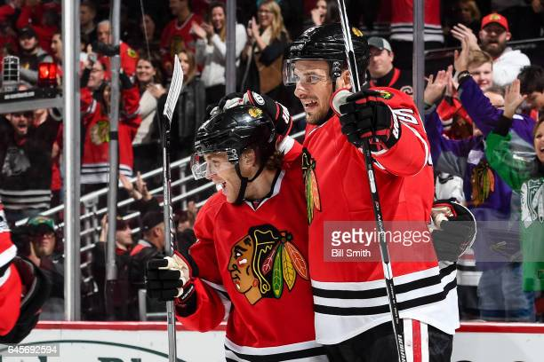 Patrick Kane and Artem Anisimov of the Chicago Blackhawks celebrate after Anisimov scored the gamewinning goal in the third period against the St...