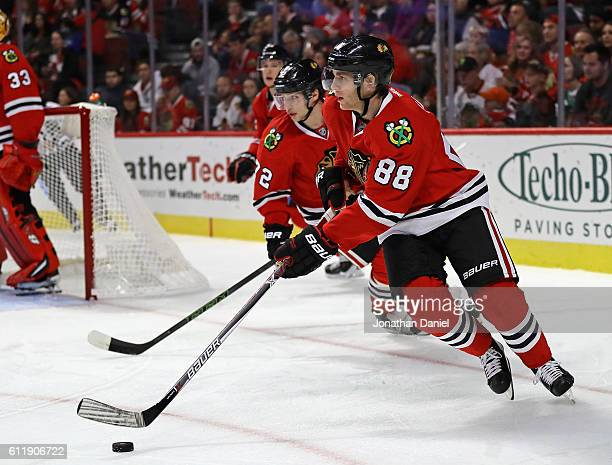 Patrick Kane and Artemi Panarin of the Chicago Blackhawks turn to move up the ice against the St Louis Blues during a preseason game at the United...