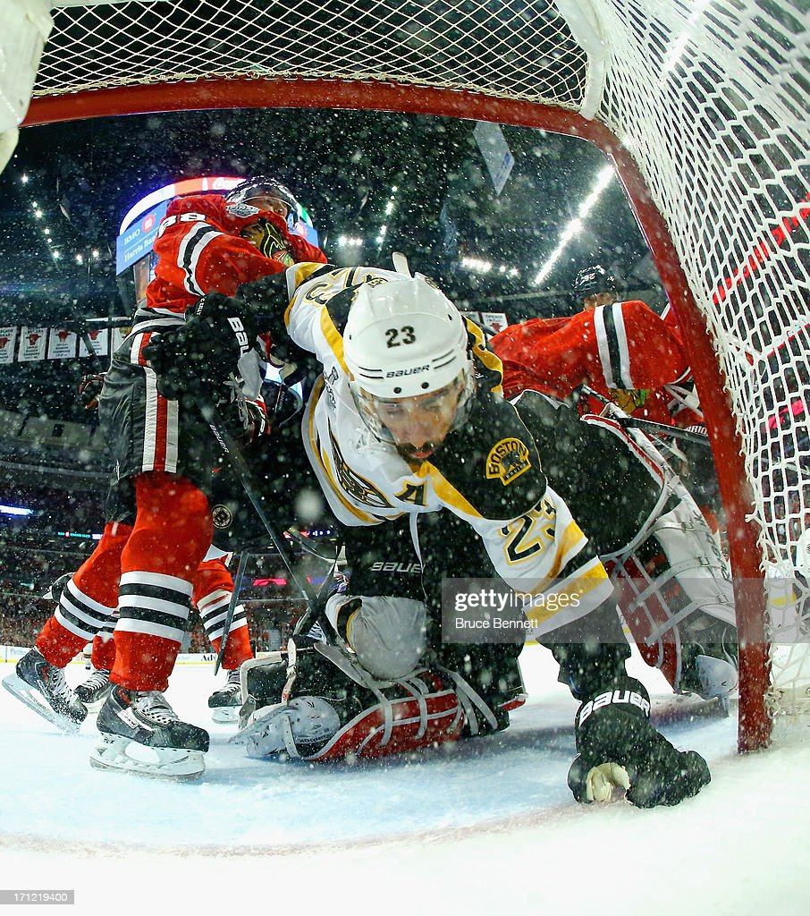 Patrick Kane #88 and goaltender Corey Crawford #50 of the Chicago Blackhawks defend the net against Chris Kelly #23 of the Boston Bruins in Game Five of the 2013 NHL Stanley Cup Final at United Center on June 22, 2013 in Chicago, Illinois. The Chicago Blackhawks defeated the Boston Bruins 3-1.