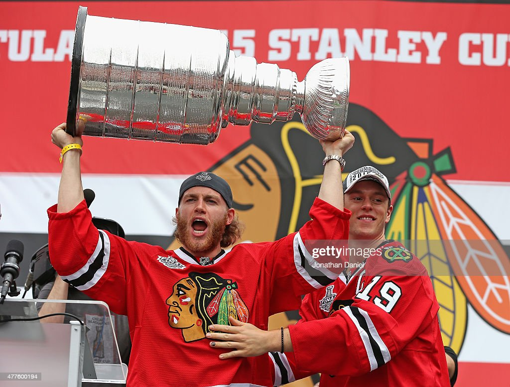 <a gi-track='captionPersonalityLinkClicked' href=/galleries/search?phrase=Patrick+Kane&family=editorial&specificpeople=1977261 ng-click='$event.stopPropagation()'>Patrick Kane</a> #88 (L) and <a gi-track='captionPersonalityLinkClicked' href=/galleries/search?phrase=Jonathan+Toews&family=editorial&specificpeople=537799 ng-click='$event.stopPropagation()'>Jonathan Toews</a> #19 of the Chicago Blackhawks acknowlegde the crowd during the Chicago Blackhawks Stanley Cup Championship Rally at Soldier Field on June 18, 2015 in Chicago, Illinois. (Photo by Jonathan Daniel/Getty Images))