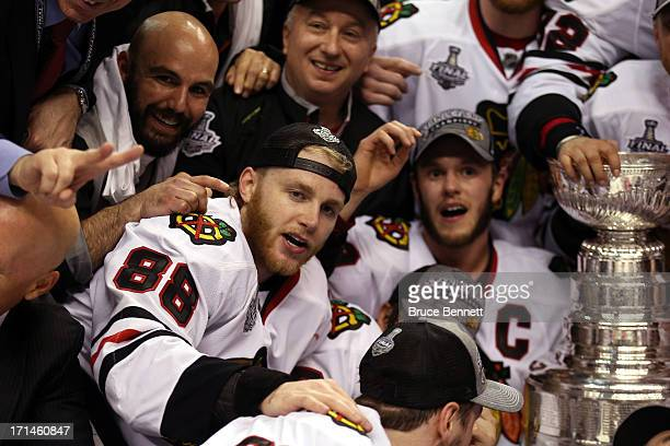 Patrick Kane and Jonathan Toews of the Chicago Blackhawks celebrate next to the Stanley Cup after they won 32 against the Boston Bruins in Game Six...