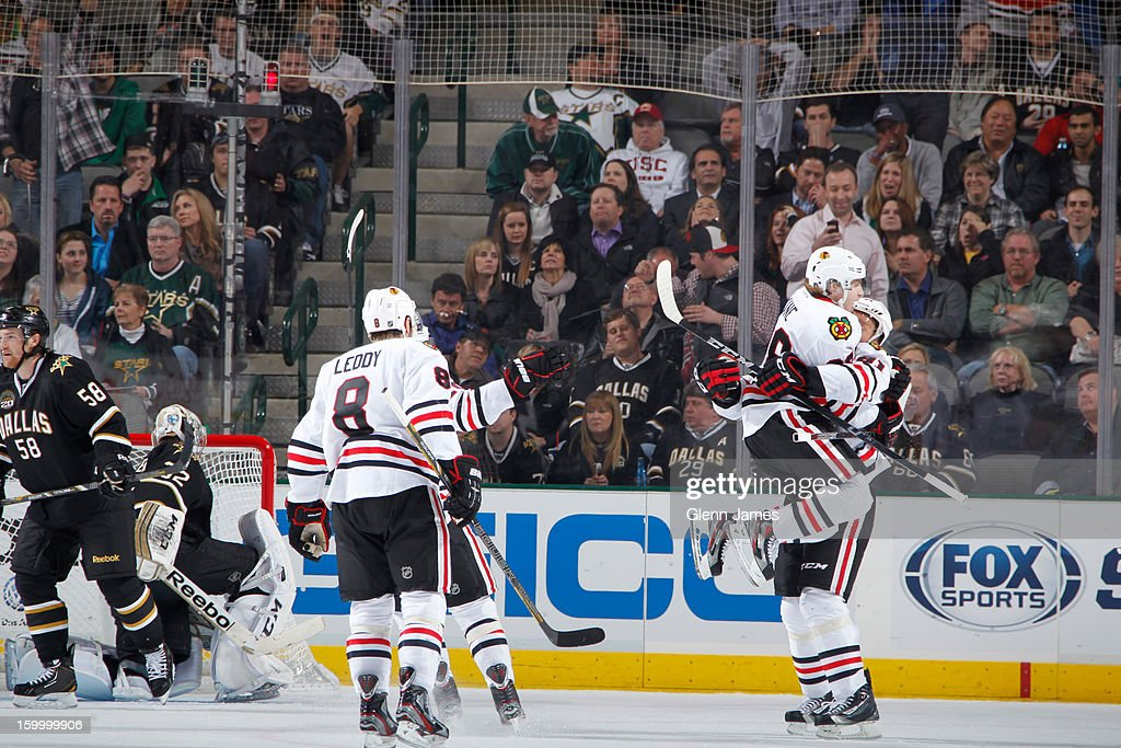 Patrick Kane #88 and Marian Hossa #81 of the Chicago Blackhawks celebrate an overtime game winning goal against the Dallas Stars at the American Airlines Center on January 24, 2013 in Dallas, Texas.