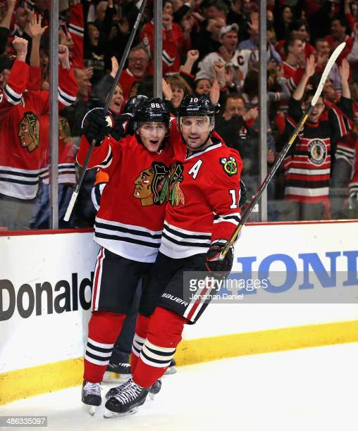 Patrick Kane and Patrick Sharp of the Chicago Blackhawks celebrate a second period goal by Kane against the St Louis Blues in Game Four of the First...