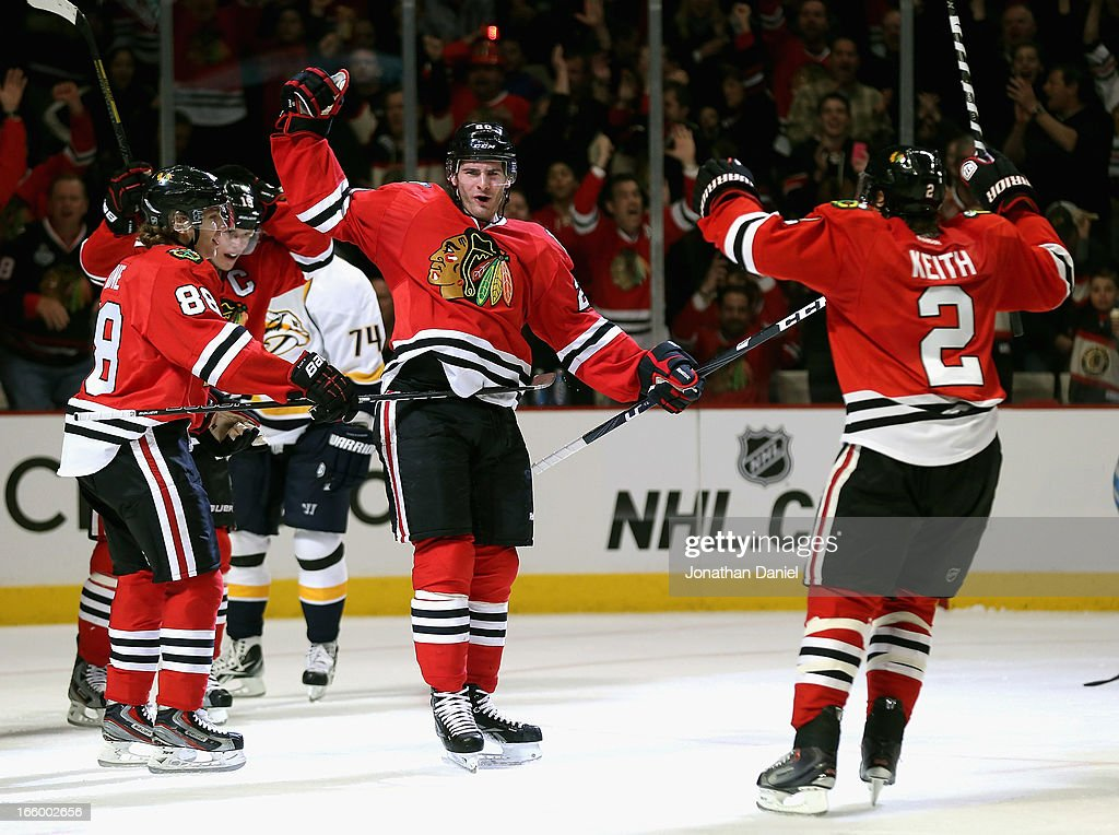 Patrick Kane #88, <a gi-track='captionPersonalityLinkClicked' href=/galleries/search?phrase=Jonathan+Toews&family=editorial&specificpeople=537799 ng-click='$event.stopPropagation()'>Jonathan Toews</a> #19, <a gi-track='captionPersonalityLinkClicked' href=/galleries/search?phrase=Brandon+Saad&family=editorial&specificpeople=7128385 ng-click='$event.stopPropagation()'>Brandon Saad</a> #20 and <a gi-track='captionPersonalityLinkClicked' href=/galleries/search?phrase=Duncan+Keith&family=editorial&specificpeople=4194433 ng-click='$event.stopPropagation()'>Duncan Keith</a> #2 of the Chicago Blackhawks celebrate Saad's third period goal against the Nashville Predators at the United Center on April 7, 2013 in Chicago, Illinois. The Blackhawks defeated the Predators 5-3.