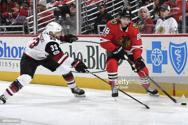 Patrick Kane of the Chicago Blackhawks and Alex Goligoski of the Arizona Coyotes chase the puck in the first period at the United Center on December...