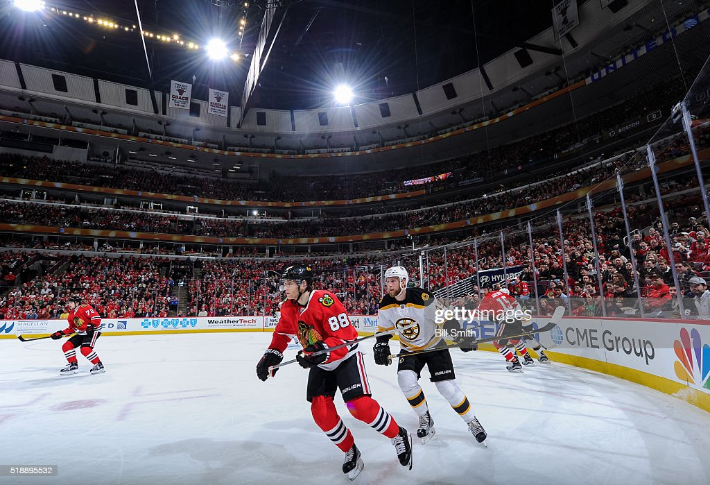 Patrick Kane of the Chicago Blackhawks and Joe Morrow of the Boston Bruins skate in the second period of the NHL game at the United Center on April 3...