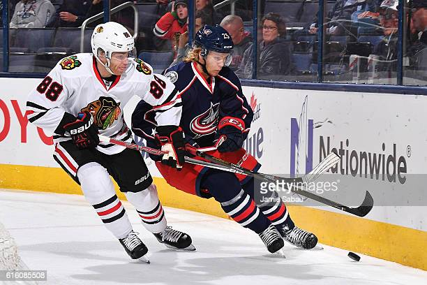 Patrick Kane of the Chicago Blackhawks and William Karlsson of the Columbus Blue Jackets battle for the puck during the first period of a game on...