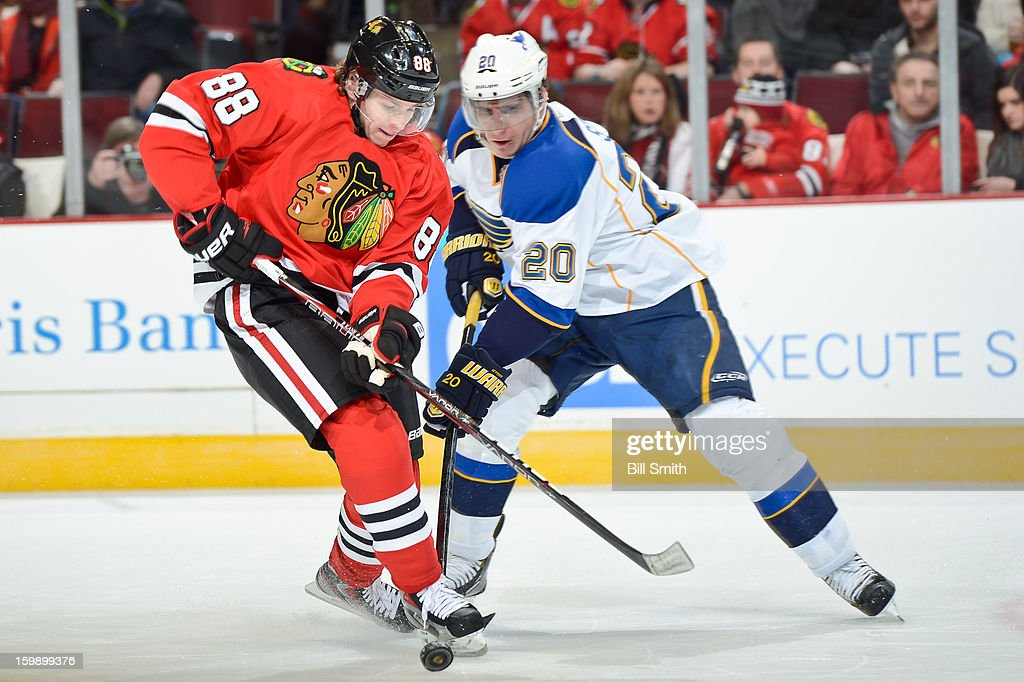 Patrick Kane #88 of the Chicago Blackhawks approaches the puck in front of Alexander Steen #20 of the St. Louis Blues during the NHL game on January 22, 2013 at the United Center in Chicago, Illinois.