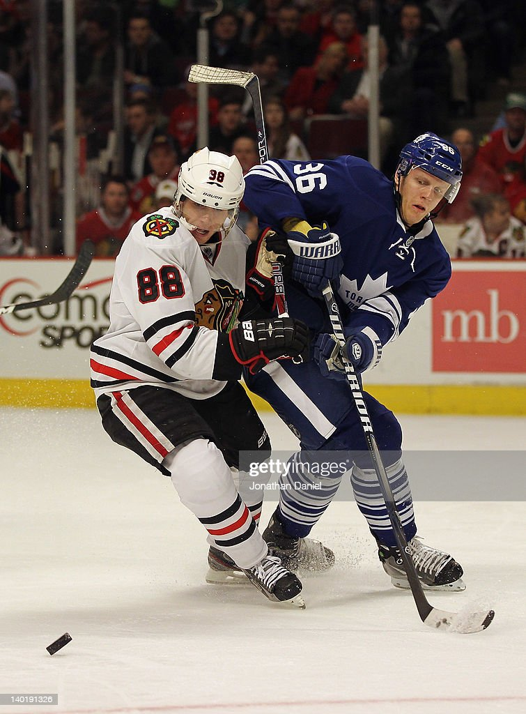 Patrick Kane #88 of the Chicago Blackhawks battles for position with <a gi-track='captionPersonalityLinkClicked' href=/galleries/search?phrase=Carl+Gunnarsson&family=editorial&specificpeople=5557315 ng-click='$event.stopPropagation()'>Carl Gunnarsson</a> #36 of the Toronto Maple Leafs at the United Center on February 29, 2012 in Chicago, Illinois.