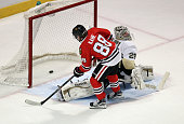Patrick Kane of the Chicago Blackhawks beats MarcAndre Fleury of the Pittsburgh Penguins during the shootout at the United Center on February 15 2015...