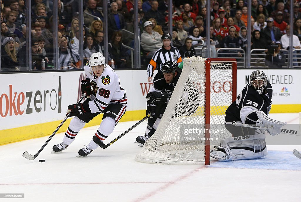 Patrick Kane #88 of the Chicago Blackhawks brings the puck around the net against <a gi-track='captionPersonalityLinkClicked' href=/galleries/search?phrase=Robyn+Regehr&family=editorial&specificpeople=171828 ng-click='$event.stopPropagation()'>Robyn Regehr</a> #44 of the Los Angeles Kings in the third period during the NHL game at Staples Center on February 3, 2014 in Los Angeles, California. The Blackhawks defeated the Kings 5-3.