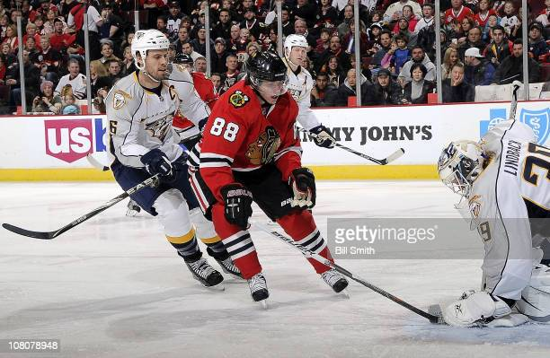 Patrick Kane of the Chicago Blackhawks can't get the puck past goalie Anders Lindback of the Nashville Predators as Shea Weber of the Predators...