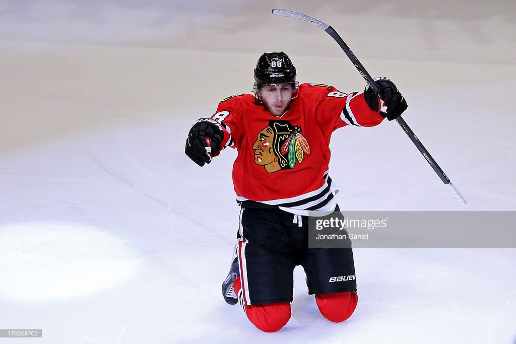 Patrick Kane #88 of the Chicago Blackhawks celebrates after he scored the game-winning goal in the second overtime period against the Los Angeles Kings during Game Five of the Western Conference Finals of the 2013 NHL Stanley Cup Playoffs at United Center on June 8, 2013 in Chicago, Illinois.