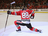 Patrick Kane of the Chicago Blackhawks celebrates after scoring his third goal of the game in the second period against the Boston Bruins at the...
