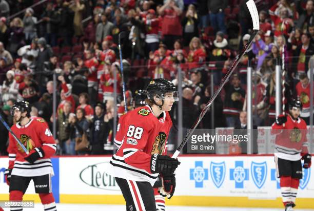 Patrick Kane of the Chicago Blackhawks celebrates after the Blackhawks defeated the Arizona Coyotes 31 at the United Center on December 10 2017 in...