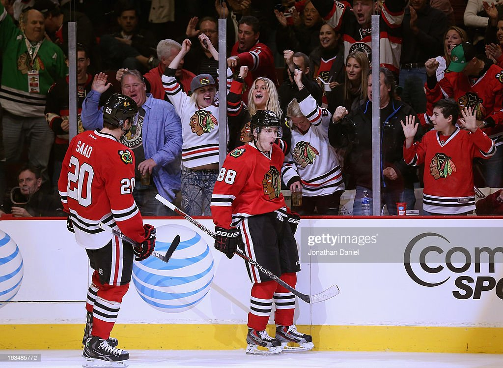 Patrick Kane #88 of the Chicago Blackhawks celebrates his goal against the Edmonton Oilers as <a gi-track='captionPersonalityLinkClicked' href=/galleries/search?phrase=Brandon+Saad&family=editorial&specificpeople=7128385 ng-click='$event.stopPropagation()'>Brandon Saad</a> #20 skates up at the United Center on March 10, 2013 in Chicago, Illinois. The Oilers defeated the Blackhawks 6-5.
