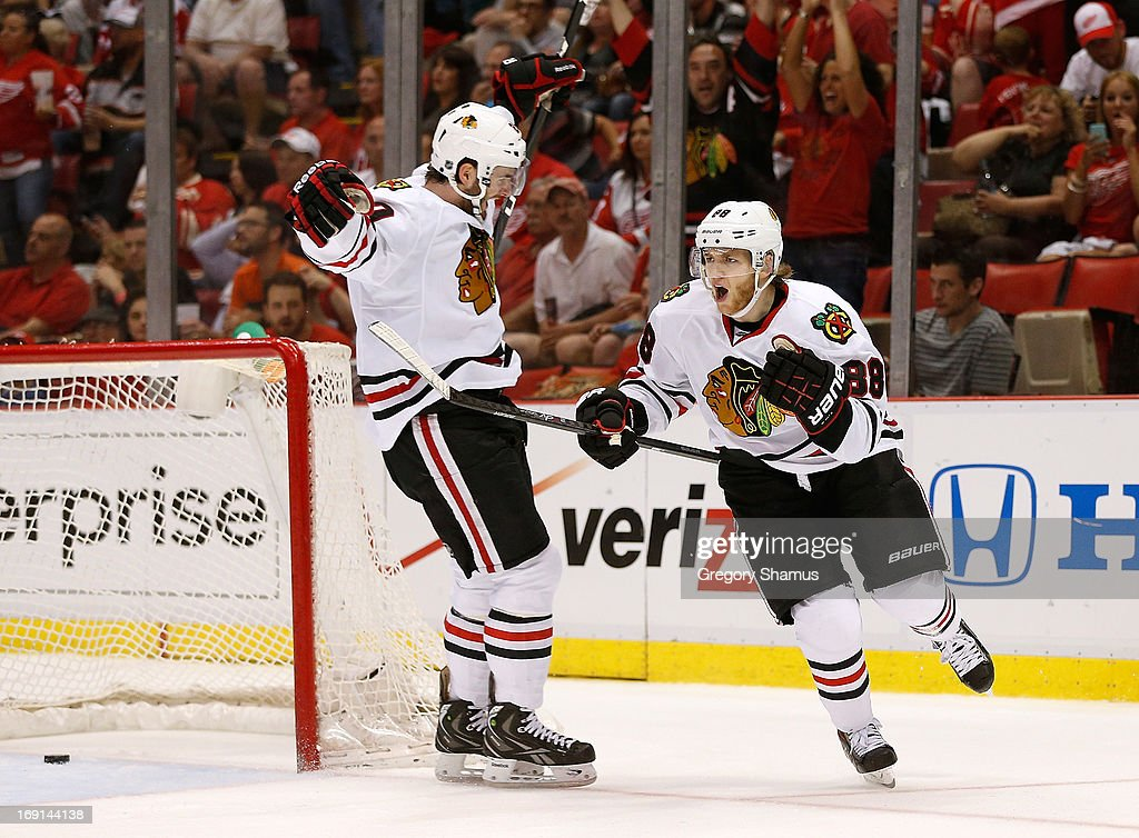 Patrick Kane #88 of the Chicago Blackhawks celebrates his third period goal with <a gi-track='captionPersonalityLinkClicked' href=/galleries/search?phrase=Brandon+Saad&family=editorial&specificpeople=7128385 ng-click='$event.stopPropagation()'>Brandon Saad</a> #20 while playing the Detroit Red Wings in Game Three of the Western Conference Semifinals during the 2013 NHL Stanley Cup Playoffs at Joe Louis Arena on May 20, 2013 in Detroit, Michigan. Detroit won the game 3-1 to take a 2-1 series lead.